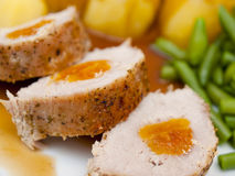 Pork loin with apricot Stock Photos