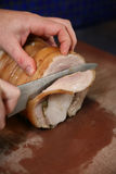 Pork Loin being sliced Royalty Free Stock Images