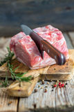 Pork loin on a cutting board. Royalty Free Stock Images
