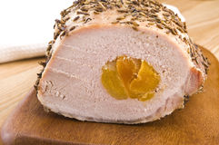 Pork loin with dried apricots Stock Images