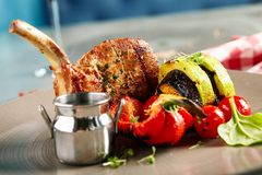 Pork Loin with Grilled Vegetables and Sauce. Gourmet Food - Pork Loin with Grilled Vegetables and Sauce Royalty Free Stock Image