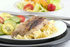 Pork loin, noodles, veggies royalty free stock photo