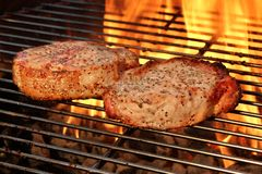 Pork Loin Pepper Steaks On The Hot BBQ Flaming Grill Royalty Free Stock Image