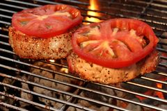 Pork Loin Pepper Steaks On The Hot BBQ Flaming Grill Stock Images