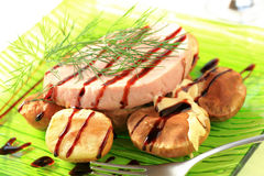 Pork loin steak and baked potatoes Stock Images