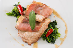 Pork loin with vegetables and chili pepper Stock Photos