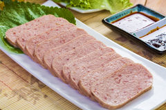 Pork Luncheon Meat. This picture shows a dish of cut pork luncheon meat Stock Image