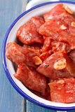 Pork in marinate with garlic. And bay leaf on dish Stock Photo