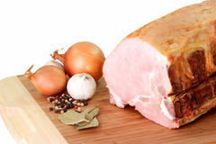 Pork meat. Raw ham meat with bone isolated on a kitchen board Stock Photography