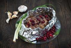 Pork meat, baked in foil Stock Image
