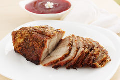 Pork meat baked. With sour cranberry sauce Stock Image