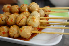 Pork meat balls. Grilled pork meat balls with spicy sauce in white dish Stock Images