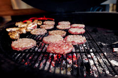 Pork meat and chicken cutlets with pepper grilling for burgers. Catering in food court at mall concept. space for text. stylish open kitchen royalty free stock photo