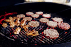 Pork meat and chicken cutlets with pepper grilling for burgers. Catering in food court at mall concept. space for text. stylish open kitchen stock image