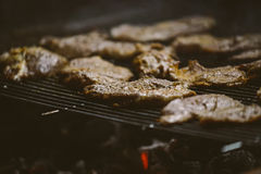 Pork meat chops on barbecue Royalty Free Stock Photo