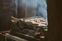 Pork meat chops on barbecue Stock Photo
