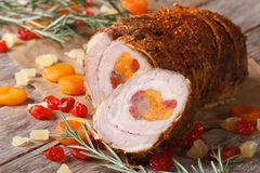 Pork meat with dried apricots, cherries and pineapple Royalty Free Stock Image