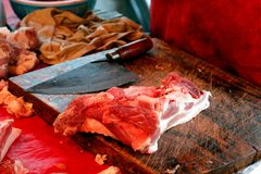 Meat fresh pork and knife in countryside market thai food stock photography