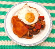Pork Meat. With a fried egg and mushrooms Stock Images