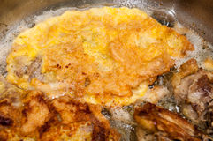 Pork meat frying in the frying pan.  Stock Image
