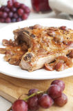 Pork meat and grape in a wine sauce Stock Photos
