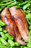 Pork meat with green beans. Appetizing pork meat tenderloin roasted with green beans Stock Photo