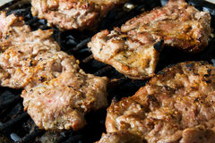Pork meat on grill Royalty Free Stock Images