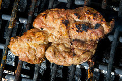 Pork meat on grill Royalty Free Stock Image