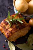 Pork meat with herbs and pepper on slate stone Royalty Free Stock Images