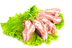 Pork meat pieces on green salad Isolated. Pork meat pieces on green salad. Isolated over white Stock Images