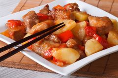 Pork meat with pineapple and vegetables in sweet and sour sauce Stock Images
