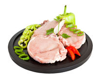 Pork meat on plate stock images