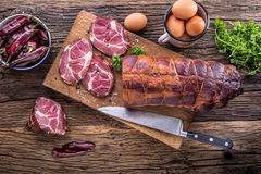 Pork meat.Pork chop smoked. Traditional smoked meat on oak wooden table in other positions.  stock photos