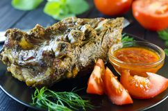 Pork meat on ribs baked in an oven Royalty Free Stock Photos