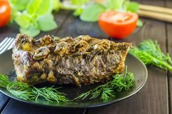 Pork meat on ribs baked in an oven Stock Image