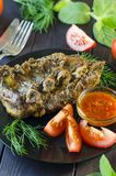 Pork meat on ribs baked in an oven Stock Images