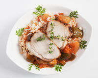 Pork meat with rice and vegetables Stock Image