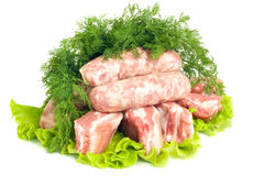Pork meat, Sausages and dill on green salad. Isolated over white Stock Photos