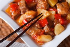 Pork meat with sweet and sour sauce macro. horizontal top view Stock Photography
