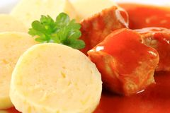 Pork meat in tomato sauce with potato dumplings Royalty Free Stock Photography