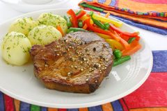 Pork meat with vegetables Stock Photo