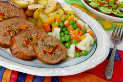 Pork meat with vegetables. Fried pork meat with vegetables Stock Photos