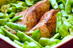 Pork meat with vegetables. Appetizing pork meat tenderloin roasted with green beans Stock Images