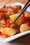 Pork meat with vegetables in sweet and sour sauce, Vertical Stock Photography