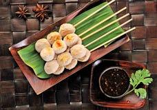 Pork meatball on bana leaves Stock Photos