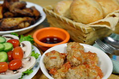 Pork meatball and salad. Pork meatball, fried chicken, salad and dinner roll Stock Photos