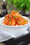 Pork meatballs with rice, carrots, peas and red sauce on a wooden table Royalty Free Stock Image