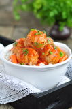 Pork meatballs with rice, carrots, peas and red sauce on a wooden table Stock Photography