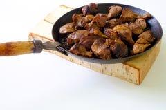 Pork med grönsaker på träbräde Royaltyfri Foto