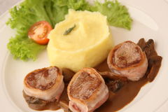 Pork medallion dish with puree Stock Photos